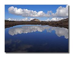 Bierstadt Summit (rianhouston) Tags: colorado reflection clouds mtbierstadt mtevans