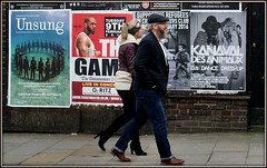 Billboards (* RICHARD M (Over 5 million views)) Tags: street candid billboards posters flyposters flyposting advertising advertisements couples smiles together beards bearded whiskers bewhiskered cap clothcap leatherjacket headband jeans denims bluejeans spectacles glasses eyeglasses pavingstones specs scousersliverpudlians liverpool merseyside europeancapitalofculture capitalofculture unescocityofmusic cityofmusic