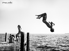 Diving Man! (Beppe Cavalleri - www.beppecavalleri.com) Tags: emotion sun reportage beach beppecavalleri movementlight run street youngwwwbeppecavallericom biancoenero bw swim lake blackwhite movement sea