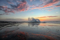 Splash of pink (pominoz) Tags: sea reflection clouds sunrise wave nsw centralcoast terrigal theskillion