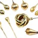 1046. Group of Gold and Goldtone Mounted Hatpins