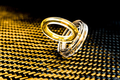 The Miracle of sticking together (Teo Morabito) Tags: wedding silver gold or jewelry bijoux jewellery rings carbon fiber argent