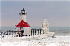 Winter in St. Joseph (Tom Gill.) Tags: lighthouse lake snow ice pier frozen michigan stjoseph lakemichigan shelfice lighthousetrek
