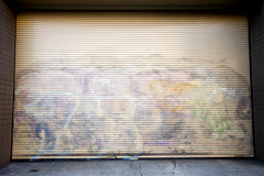 Buff (jkoshi) Tags: door art graffiti paint garage faded vandalism buffed koshi jkoshi