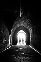 end of the tunnel (Jos Mecklenfeld) Tags: light people bw netherlands dark gate tunnel zeeland ricoh vlissingen poort gx200 ricohgx200