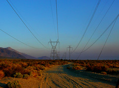 Wires Into the Sky (lefeber) Tags: california road mountains backlight landscape vanishingpoint haze shadows desert perspective roadtrip powerlines wires valley plus dirtroad hazy bushes eveninglight owensvalley atmosphericperspective sierranevadamountains