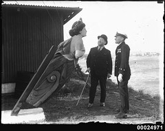 Sir Robert Archdale Parkhill inspects a ship's figurehead at Snapper Island, Sydney