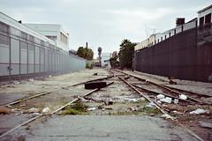 junk tire on track. (howard-f) Tags: urban abandoned trash junk nikon track industrial urbandecay debris roadside fullframe nikkor fx warehouses railroadtrack d700 freighttrack afs2485f3545gedvr