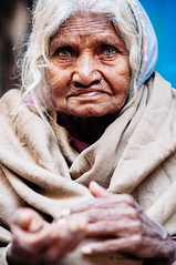 Elder woman begging in the streets of the old town. Varanasi, benares, Uttar Pradesh, India (achel cabonell) Tags: street old city travel portrait urban woman india senior vertical closeup outdoors town alley asia indian beggar viajes alleyway elder varanasi begging benares ghat uttarpradesh travelphotography colorimage indianculture lookingatcamera documentaryphotography fotografiadocumental fotografiadeviajes rachelcarbonell