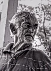 Mr. Baker († B.H.B. PHOTOGRAPHY †) Tags: old blackandwhite bw man black georgia flickr baker oldman talking frontporch stripedshirt greyhair