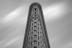 Flatiron Building NYC (wowography.com) Tags: newyorkcity sky bw usa ny composite skyline architecture clouds photoshop google nikon manhattan midtown explore edge handheld nik fifthavenue renaissance flatiron hdr lightroom beauxarts 18200mm fullerbuilding 2013 cs5 dfine2 silverefexpro 150173 wowographycom weeemy50thexplore
