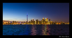 Toronto (D.Lundin) Tags: city light sunset urban toronto ontario canada reflection building tower colors beautiful skyline architecture night clouds reflections cntower explore nighttime kanada