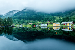 Reflections, colors and fog [Explore #47] (Richard Larssen) Tags: world houses sea mountain reflection college water norway misty fog forest landscape mirror norge long exposure day cloudy sony united norwegen center richard flekke scandinavia rehab a77 sogn fjordane haugland larssen