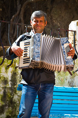 Busker In Torremolinos (Phil_Lid) Tags: beach sunshine busker torremolinos southspain accordianplayer