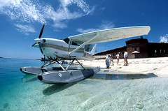Seaplane on the beach at Fort Jefferson: Garden Key, Dry Tortugas, Florida (State Library and Archives of Florida) Tags: ocean blue sky tourism beach water clouds islands florida aircraft airplanes tourists fortification nationalparks seaplanes forts floridakeys fortjefferson drytortugas floatplane gardenkey drytortugasnationalpark statelibraryandarchivesofflorida coastdefenses dalemmcdonaldcollection