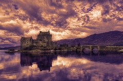 Eilean Donan Castle Blazing Sunset - Scotland (Edition 02) (Mister Joe) Tags: uk bridge sunset sky lake castle church water stone clouds island scotland highlands pond ancient nikon ruins scenery unitedkingdom famous dramatic scottish arches landmark joe historic mackenzie celtic loch dynamicrange martyr photographed stronghold fortress iconic hdr uprising eileandonan macrae 1719 dornie jacobite lochduich rebellions thirteencentury donnain donnnofeigg johnmacraegilstrap kintailnationalscenicarea