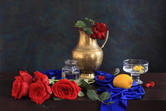 My Sunlit Angels (panga_ua) Tags: flowers roses stilllife color art love glass floral beauty crimson fruit composition canon spectacular lights visions petals lemon artwork shadows darkness artistic availablelight ukraine poetic explore creation angels harmony imagination natalie sunlit chiaroscuro arrangement folds tabletop divinity redroses bodegon naturemorte panga artisticphotography rivne naturamorta artphotography myroses fadedrose sharpfocus bluefabric explored yellowbegonia woodentabletop brasspitcher crimsonroses  nataliepanga glassfootedbowl pastelsbackground lyingroses mysunlitangels squareglassjar splashesofblood