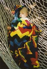 Colorful Knitted Blanket (Heath & the B.L.T. boys) Tags: benjamin sleeping yard hammock blanket film yarn