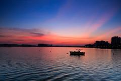 A Last Minute Sunset (Shutter wide shut) Tags: sunset lake colors boat singapore dusk serenity ripples pandanreservoir singhraylbwarmingpolarizer canoneos5dmarkiii canontse24mmf35lii singhrayreversendgradfilter
