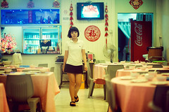 Restaurant Closing Time (Jon Siegel) Tags: woman girl beautiful night walking restaurant evening nikon singapore f14 14 chinese 85mm waitress closing nikkor singaporean 85mm14 d700 nikkor85mmf14afd