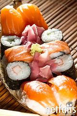Yummy Fresh Sushi rolls (Netfalls) Tags: food fish sushi japanese different rice many maki crab tasty plate shrimp fresh bamboo snack meal chopsticks seafood roll nigiri appetizer scallop tuna isolated chirashi asain oshi sweetshrimp