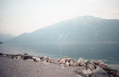 Limone sul Garda - Film (Alessandra Papagni) Tags: blue outdoor aperto lago lake garda limone italia italy italie water acqua landscape paesaggio relax pace peace indie hipster dream dreamy pastel color eau lac paysage analog photography fotografia analogica analogic analogue argentique 35mm 35 mm 50mm 50 canon ae1 ae 1 film roll rolls pellicule kodak plus colorplus 200 iso asa nature natura natural naturale light luce morning afternoon pomeriggio sole sunny summer travel holiday vacanza vintage sky cielo ciel stones storeline mountains