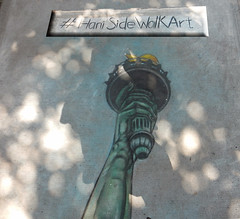 Sidewalk Art (TheMachineStops) Tags: 2016 outdoor sidewalk art pavement harlem nyc hani urbanart streetart statueofliberty torch photoshop newyorkcity
