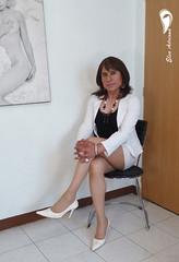 White high heels, white Fitted skirt, black blouse and white coat. (Elsa Adriana) Tags: elsaadriana crossdresser tgirl transvestite travesti highheels white mature