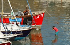 Reflecting Photographer. (howell.davies) Tags: photographer reflection reflections boats water sea tide harbour marine people seaside tenby pembrokeshire wales uk nikon d3200 55200vr