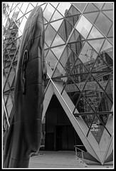 The Gherkin with sculpture in foreground (jim_2wilson) Tags: gherkin sculpture london jimwilson sonya99 minolta1735mmf28f4 bw dxoopticspro ppb698