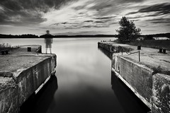 abandoned ferry dock (twurdemann) Tags: 60seconds abandoned bamfortisland blackandwhite clouds evening ferrydock fujixt1 ghost highway548 hoyandx64 lakehuron longexposure neutraldensityfilter niksilverefex northchannel northernontario ontario seascape selfie shoreline sky stjosephchannel stjosephisland summer sunset tarbutttownship toad water xf1855mm