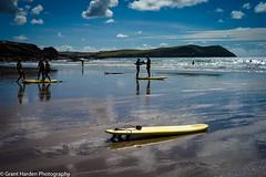 L1002545 (granth2903) Tags: leica m9 voightlander 35 25 cornwall polzeath beach beachside sea seascape seaside surf surfing water watersports reflections sky summer wwwgranthardenphotographycom