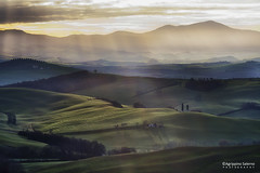 Rays of light (Agrippino Salerno) Tags: valdorcia italy tuscany morning sanquiricodorcia light shadow green clouds hills countryside agrippinosalerno canon sky colors country countryroad travel goldenhour