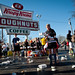 Krispy Kreme Challenge participants make a determined effort to consume the required dozen doughnuts.