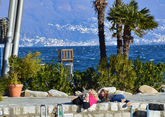 Enjoying wind (Irene Grassi (sun sand & sea)) Tags: people italy lake nature children lago pier italia gente wind bambini natura piemonte molo vento lagomaggiore cannobio lidodicannobio parcolido