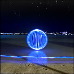 Caribbean Blue (Rodrick Dale) Tags: blue sea lightpainting beach water night reflections orb