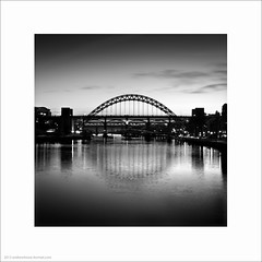 Tyne Bridges (Andrew James Howe) Tags: uk bridge light england blackandwhite reflection architecture clouds buildings reflections river landscape industrial dusk fineart bridges engineering tyne tynebridge newcastleupontyne rivertyne highlevelbridge andrewhowe