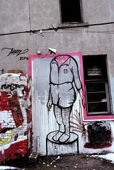 Beheaded (Georgie_grrl) Tags: streetart toronto ontario graffiti 1 expression creative stumpy stump pentaxk1000 stumped beheaded rikenon12828mm losinghishead ormaybehismind someonedidntlikethedismemberedheaditseems ooohpinkblood