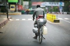 There goes the milk-man (N A Y E E M) Tags: street bicycle windshield bangladesh milkman chittagong laalkhanbazaar