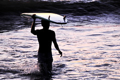 Local Surfer, Kuta Beach (masyogi) Tags: sunset bali beach silhouette indonesia nikon surfer tamron kuta 70300 d300