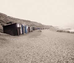(Khadijah Turner) Tags: sea england beach rocks waves gloomy pebbles calm huts bartononsea