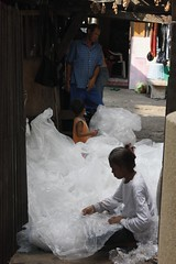 Somjais job is to prep plastic bags before they are sold to a recycling plant in Bangkok (nextcityorg) Tags: poverty travel trash thailand bangkok cities recycling urbanism neighborhoods slums developingworld informalsector globalpoverty informaleconomy informality slumdwellers wastepickers forumforthefuture rockefellerfoundation informalsettlements nextcity inclusivecities nextcityorg informalcitydialogues nextcityorginformalcity