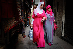 Pink women in the medina (Lil [Kristen Elsby]) Tags: africa travel pink shopping northafrica robe muslim hijab streetphotography morocco maroc getty editorial medina gown slippers oldcity tangier moroccan tanger gettyimages tangiers reportage topv7777 brightpink 5x4 babouche travelphotography djellaba jellaba canon5dmarkii