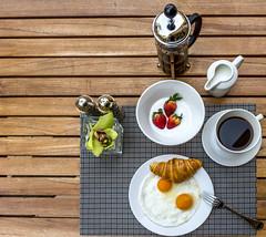 A healthy breakfast (arielcaguin) Tags: croissant table tablesetup coffee coffeepot coffeebreak yoghurt milk egg sunnysideup breakfast bread saltpepper
