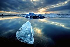Glacier Lagoon III (TXA Photography) Tags: iceland glacier sun sky sunset jkulsrln glacierlagoon longexposure vatnajokull icelandphototours fourseasons cold reflection waterscape seascape landscape scenic ice winter