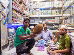 Shop keepers show jackfruit they are planning to eat for Iftar (karla.hovde) Tags: stall market bazar dhaka bangladesh asia travel street food outdoor urban muslim ramadan people jackfruit fruit fast iftar meal shopkeeper lungi