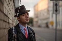 DSC_8441 (Altvod) Tags:  portrait street   barbedwire wall   brickwall hat   tie necktie people
