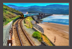 Watching the Train (Kevin, from Manchester) Tags: viaduct trains transport railwaylines barmouth wales sea sky mountains hdr canon1855mm sand kevinwalker photoborder bridge