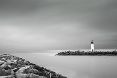 Santa Cruz Harbor Walton Lighthouse (anishsid) Tags: d7000 2470f28 bayarea california longexposure water nd110 ndfilter bw 77mm30nd110 waltonlighthouse lighthouse santacruz pacificocean pacific cloudy sunrise monochrome harbor blackandwhite day flickr10 black