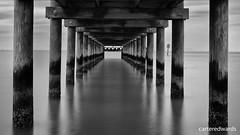 The Calm of Fairhope (Lumagent Morple) Tags: longexposure blackandwhite water pier alabama fairhope mobilebay bwnd11030 silverefexpro2 fujifilmxpro1 fujinonxf35mmf14